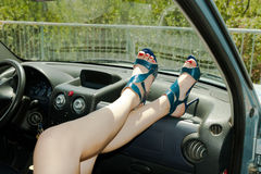 Girl put your feet on car dashboard Stock Image
