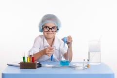 Girl puts laboratory experience Stock Photo