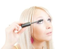 The girl puts mascara on. Stock Photography