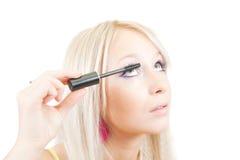 The girl puts mascara on. Stock Photography