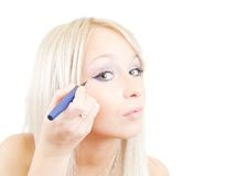 The girl puts mascara on Stock Photo