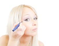 The girl puts mascara on Stock Photo
