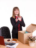 Girl puts a photo frame on desktop in office Royalty Free Stock Photo