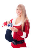 Girl puts a present into the sock Stock Images