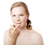 Girl puts on skin cream Royalty Free Stock Photos