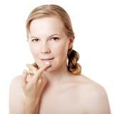 Girl puts on skin cream Royalty Free Stock Photos