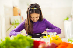 Girl puts a snack in a bag for school Royalty Free Stock Photo