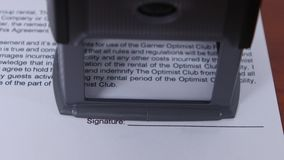 Girl puts a stamp on a document is denied. Close up stock footage