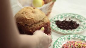 The girl puts on the table the blank for the Easter cake. Home-made bread. stock footage