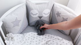 Girl puts to bed soft toy stock footage