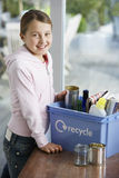 Girl Putting Empty Vessels Into Recycling Container Stock Photos