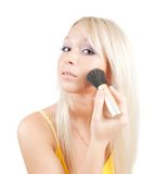 Girl putting facial powder Royalty Free Stock Photo