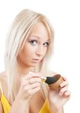 Girl putting facial powder  with a brush Royalty Free Stock Images