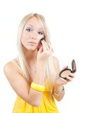 Girl putting facial powder on her face Royalty Free Stock Photography