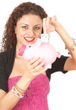 Girl putting five euro in piggy bank Royalty Free Stock Image
