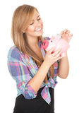 Girl putting five euro in piggy bank Stock Photography