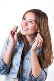 Girl putting headphones Royalty Free Stock Photos