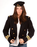 Girl putting on her officer uniform Stock Photography