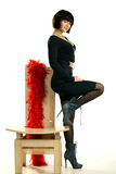 Girl is putting his foot on a wooden chair royalty free stock photography