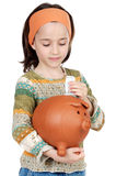 Girl putting its savings Stock Images