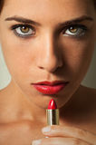 Lipstick Girl. Vertical photo of a beautiful young girl with red lipstick royalty free stock photos