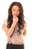 Girl putting lipstick. Stock Images
