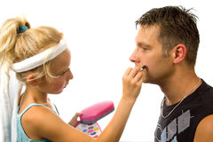 Girl is putting makeup on her father Stock Photos