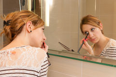 Girl Putting Makeup Stock Photography