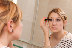 Girl Putting Makeup Royalty Free Stock Photos