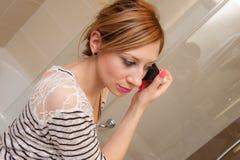 Girl Putting Makeup Stock Image