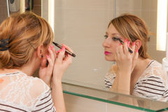 Girl Putting Makeup Stock Images