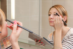 Girl Putting Makeup Stock Photos