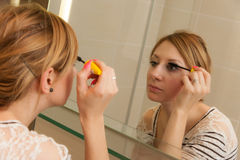 Girl Putting Makeup Stock Image