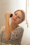 Girl Putting Makeup Royalty Free Stock Image