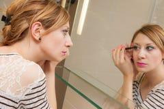 Girl Putting Makeup Stock Images