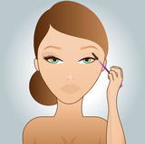 Girl putting on mascara Stock Photo
