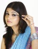 girl putting on mascara Stock Images