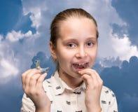 Girl putting on medical braces Stock Photo