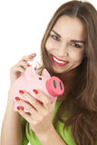 Girl putting money into piggybank Stock Photography