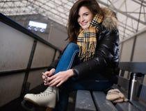 Girl putting on skates Stock Photo