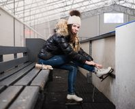 Girl putting on skates Royalty Free Stock Photography
