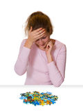 Girl and puzzle Royalty Free Stock Photos
