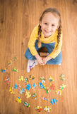 Girl with puzzle Royalty Free Stock Photos