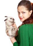 Girl and pygmy rabbit Royalty Free Stock Photo
