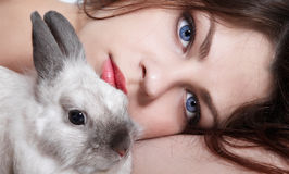 Girl and pygmy rabbit Stock Photo