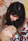 Girl and pygmy rabbit Stock Photos