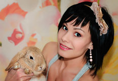 Girl and pygmy rabbit Royalty Free Stock Photo