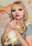 Girl and pygmy rabbit Royalty Free Stock Image