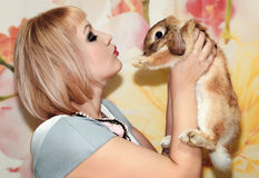 Girl and pygmy rabbit Stock Photography