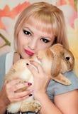 Girl and pygmy rabbit Stock Photo